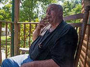 Man smoking on porch